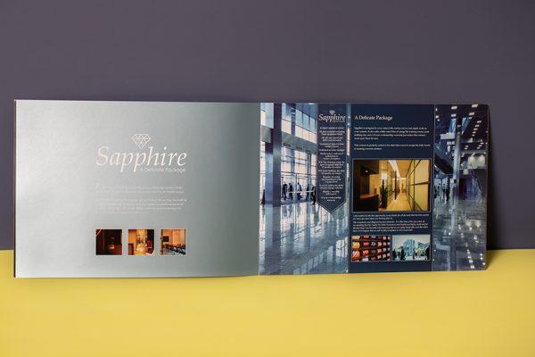 Hentland brochure with spot UV, foil block, translucent paper, spot metallic Pantone colours