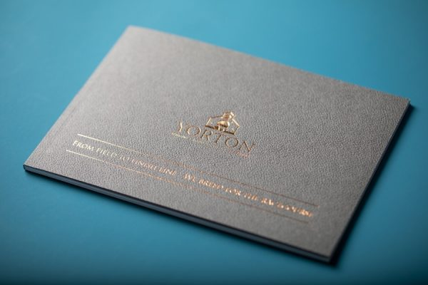 Yorton Embossed Bronze Foil printing with Perfect Bound Brochure