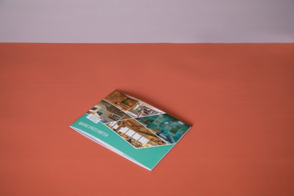 Soft-touch brochure with short-edge saddle-stitched spine