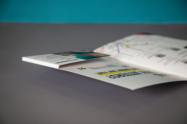 Volvelle brochure printing with brochure pocket