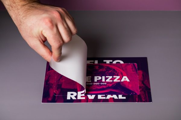 Peel and reveal card with unique code