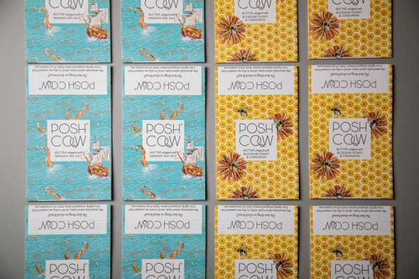 Posh Cow Dairy Packaging Sleeves with Gold Foiling by Newton Print