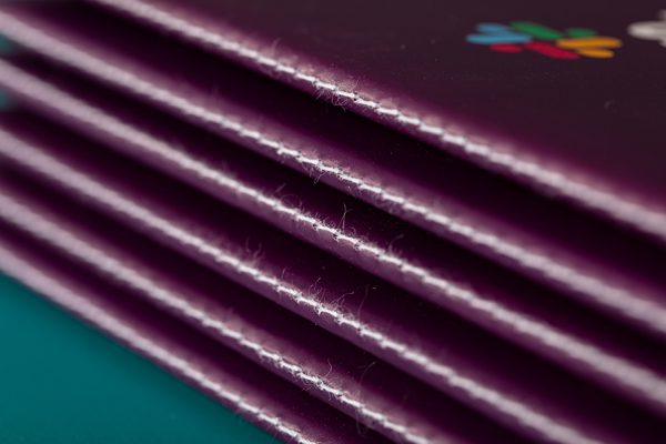 Thread sewn binding and brochure printing with Newton Print